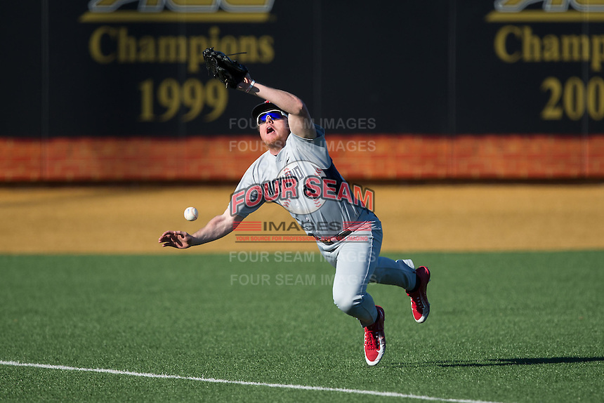 Richmond Spiders left fielder Kyle Adams (4) can't make the catch on a fly ball during the game against the Wake Forest Demon Deacons at David F. Couch Ballpark on March 6, 2016 in Winston-Salem, North Carolina.  The Demon Deacons defeated the Spiders 17-4.  (Brian Westerholt/Four Seam Images)