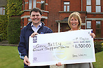 Presentation of Cheque from Brian Whelan to Ann Tracey of the Gary Kelly Centre...(Photo credit should read www.newsfile.ie)....This Picture has been sent you under the conditions enclosed by:.Newsfile Ltd..The Studio,.Millmount Abbey,.Drogheda,.Co Meath..Ireland..Tel: +353(0)41-9871240.Fax: +353(0)41-9871260.GSM: +353(0)86-2500958.email: pictures@newsfile.ie.www.newsfile.ie.