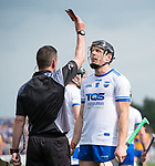 Referee Paud O Dwyer shows a red card to Kevin Moran of Waterford  during their Munster  championship round robin game at Cusack Park Photograph by John Kelly.