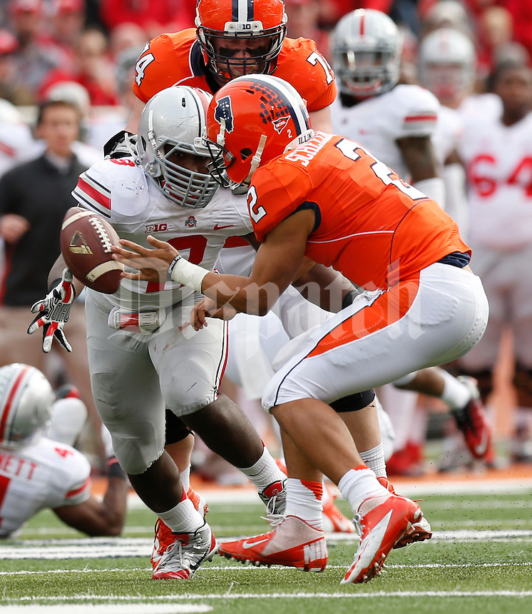 Ohio State Buckeyes defensive lineman Noah Spence (8) dives for a ball that was knocked out of the hands of Illinois Fighting Illini quarterback Nathan Scheelhaase (2) during the second half of Saturday's NCAA Division I football game at Memorial Stadium in Champaign, Il., on November 16, 2013. Ohio State won the game 60-35. (Barbara J. Perenic/The Columbus Dispatch)