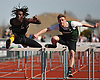 Malik Stoddart of Wyandanch, left, and Ryan Cummings of Bellmore JFK compete in the boys 110 meter high hurdles event during the Cougar Invitational held at Bellmore JFK High School on Saturday, Apr. 16, 2016. Cummings finished second in the race with a time of 15.2 while Stoddart took third at 15.4.