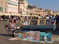 Artist displays painting in piazza Chioggia Italy
