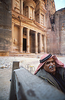 Tour guide at the entrance to the iconic ruins at Petra, Jordan