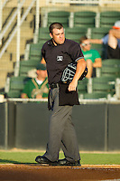 Home plate umpire Cody Oakes between innings of the South Atlantic League game between the Greensboro Grasshoppers and the Kannapolis Intimidators at CMC-Northeast Stadium on July 15, 2013 in Kannapolis, North Carolina.  The Intimidators defeated the Grasshoppers 4-0.   (Brian Westerholt/Four Seam Images)