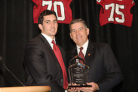 14 January 2007: Bob Bowlsby presents an award to Mike Silva at the annual football banquet at McCaw Hall in Stanford, CA.