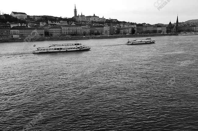 Two pleasure boats made their way up the Danube in the middle of Budapest, Hungary, March 23, 2008