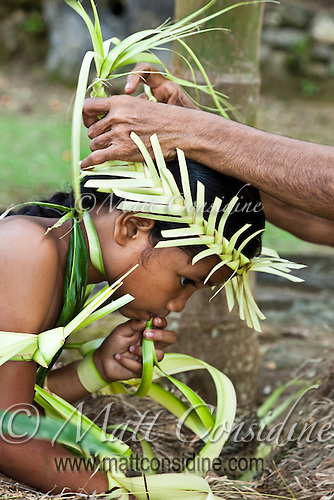 Elder matriarch helping a young girl prepare for a traditional dance. These interactions are one way in which the cultural traditions are passed from one generation to another. Yap Micronesia (Photo by Matt Considine - Images of Asia Collection) (Matt Considine)