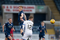 4th January 2020; Dens Park, Dundee, Scotland; Scottish Championship Football, Dundee FC versus Inverness Caledonian Thistle; Danny Johnson of Dundee competes in the air with Kevin McHattie of Inverness Caledonian Thistle  - Editorial Use