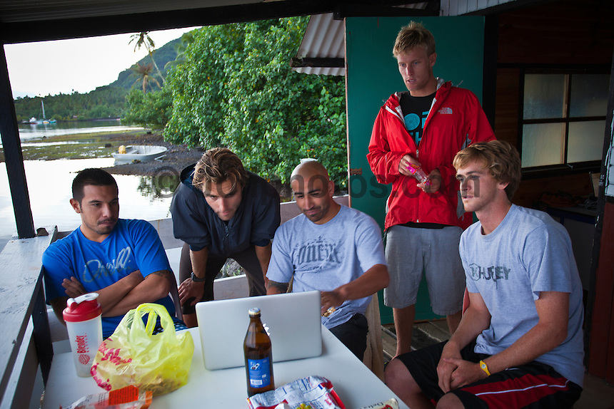 Manny, Bobby Martinez's freind, Nat Yeoman, Bobby Martinez, Pat Gudauskas, CJ Hobgood and Brett Simpson on the deck of Joli's Tahitiian hut. Sunday August 22, 2010. Rainy day with small surf in Teahupo'o Tahiti, French Polynesia.  Photo: joliphotos.com
