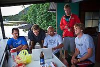 Manny, Bobby Martinez's freind, Nat Yeoman, Bobby Martinez, Pat Gudauskas, CJ Hobgood and Brett Simpson on the deck of Joli's Tahitiian hut. Sunday August 22, 2010. Rainy day with small surf in Teahupo'o Tahiti, French Polynesia.  Photo: joliphotos.com