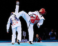 04 DEC 2011 - LONDON, GBR - Hye-Mi Park (KOR) (on right, in red) battles with Anastasia Baryshnikova (RUS) (on left, in blue) during their women's +67kg category semi final contest at the London International Taekwondo Invitational and 2012 Olympic Games test event at the ExCel Exhibition Centre in London, Great Britain .(PHOTO (C) NIGEL FARROW)