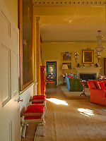 The drawing room is furnished with a large Aubusson rug and a pair of antique stools from a Parisian flea market