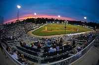 The sun sets down the left field line during the South Atlantic League game between the Asheville Tourists and the Kannapolis Intimidators at Intimidators Stadium on May 28, 2016 in Kannapolis, North Carolina.  (Brian Westerholt/Four Seam Images)