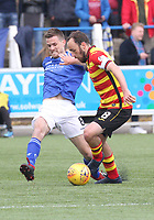 Kyle Jacobs being pressured by Stuart Bannigan in the SPFL Ladbrokes Championship football match between Queen of the South and Partick Thistle at Palmerston Park, Dumfries on  4.5.19.