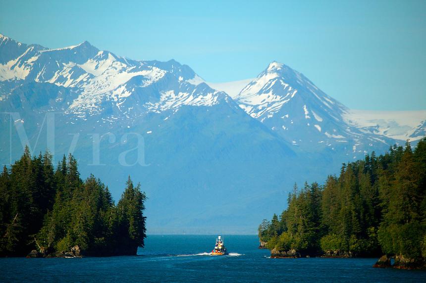 A boat passing inside Entrance Island, Valdez Narrows, from the Alaska State Ferry Aurora, Prince William Sound, Alaska