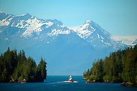 A boat passing inside Entrance Island, Valdez Narrows, from the Alaska State Ferry Aurora, Prince William Sound, Alaska
