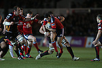 Fullback Felix Jones drives Munster forward.<br /> RaboDirect Pro12<br /> Newport Gwent Dragons v Munster<br /> Rodney Parade - Newport<br /> 29.11.13<br /> ©Steve Pope-SPORTINGWALES