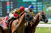 ELMONT, NY - JUNE 09: Bee Jersey  #10, ridden by Ricardo Santana, pokes a nose in front of #1, Mind Your Biscuits, ridden by Joel Rosario to win the Runhappy Metropolitan Handicap on Belmont Stakes Day at Belmont Park on June 9, 2018 in Elmont, New York. (Photo by Eric Patterson/Eclipse Sportswire/Getty Images)