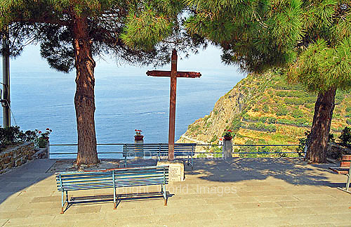 A cross and benches overlook the Mediterranean sea from Riomaggorie, Cinque Terre, Italy