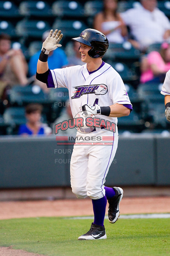 Chris Curley (4) of the Winston-Salem Dash is all smiles as he returns to the dugout after hitting a home run against the Potomac Nationals at BB&T Ballpark on July 8, 2013 in Winston-Salem, North Carolina.  The Dash defeated the Nationals 12-9.  (Brian Westerholt/Four Seam Images)