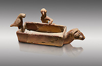 Assyrian Trader Colony Bronze Age terracotta sandal shaped ritual vessed. This cult pot is boat shaped with an animal head at the front. Inside the vessel is god. The deities associated with the ritual vessel were associated with trade and transportation in Ancient Mesopotamia and Summerian literature. The vessel signifies a religious river trip.  - 19th  century BC - Kültepe Kanesh - Museum of Anatolian Civilisations, Ankara, Turkey. Against a grey background.
