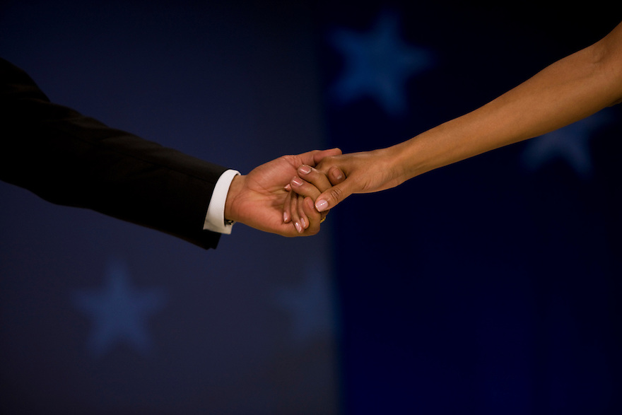 President Barack Obama and First lady Michelle Obama hold hands at the Biden Home State Inaugural Ball in Washington, Tuesday, Jan. 20, 2009...Photo by Brooks Kraft/Corbis.......