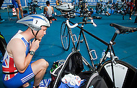 09 SEP 2011 - BEIJING, CHN - Iain Dawson prepares in transition for the start of the 2011 ITU World Paratriathlon Championships .(PHOTO (C) NIGEL FARROW)