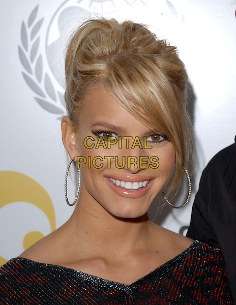 JESSICA SIMPSON.Will.i.am Music Group and RBK's Tsunami Relief Benefit Concert held at Avalon in Hollywood, California .February 11th, 2005.headshot portrait sweeping fringe hoop earrings pink lipstick lipliner.www.capitalpictures.com.sales@capitalpictures.com.Supplied By Capital PIctures