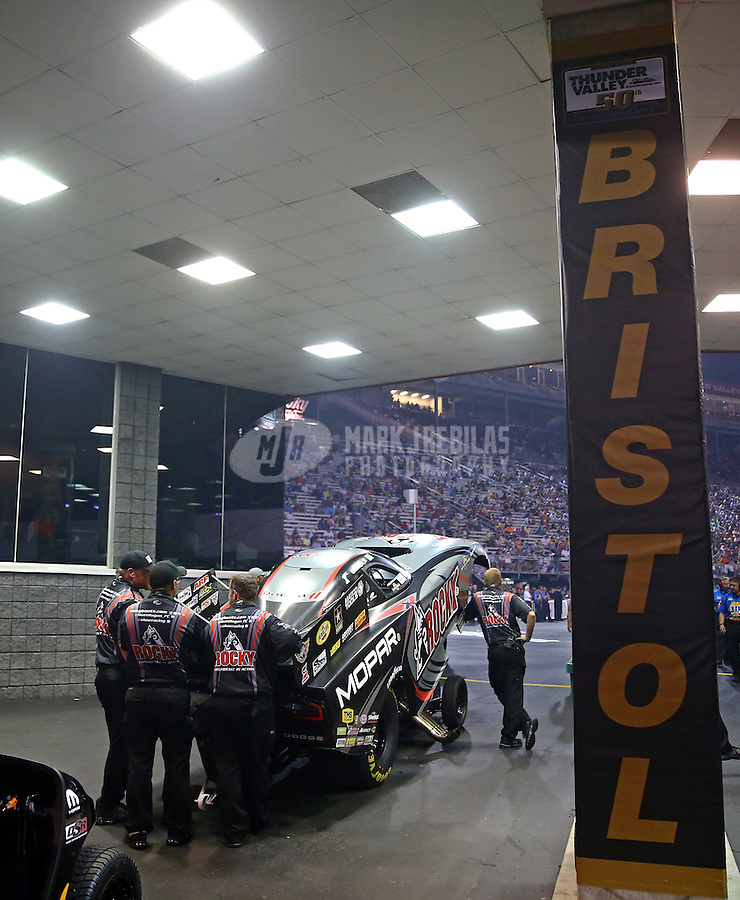 Jun 19, 2015; Bristol, TN, USA; Crew members wait in the staging lanes with NHRA funny car driver Matt Hagan during qualifying for the Thunder Valley Nationals at Bristol Dragway. Mandatory Credit: Mark J. Rebilas-