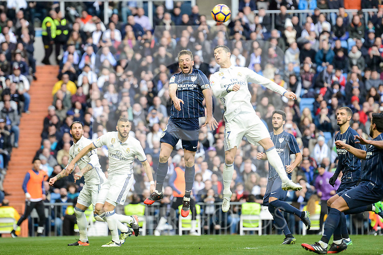 Real Madrid's Sergio Ramos, Karim Benzema and Cristiano Ronaldo during La Liga match between Real Madrid and Malaga CF at Santiago Bernabeu Stadium in Madrid, Spain. January 21, 2017. (ALTERPHOTOS/BorjaB.Hojas)