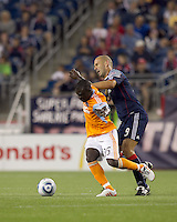 New England Revolution forward Ilica Stojica (9) disrupts Houston Dynamo midfielder Anthony Obodai (35) dribble. The New England Revolution defeated Houston Dynamo, 1-0, at Gillette Stadium on August 14, 2010.