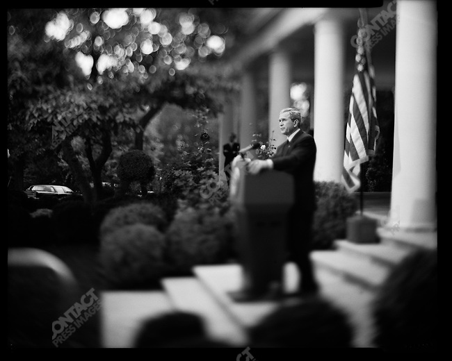 President George W Bush speaks to the press in the Rose Garden of the White House, speaking primarily about the situation in Iraq and Afghanistan. Washington D.C. October 28, 2003.