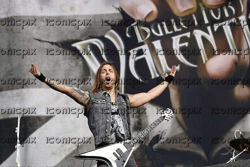 BULLET FOR MY VALENTINE -  vocalist and rhythm gutiarist Matthew Tuck - performing live the main stage on Day 3 at the 2012 Reading Festival held in Reading UK -  26 Aug 2012.  Photo credit: Dean Fardell/IconicPix