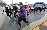 NWA Arkansas Democrat-Gazette/DAVID GOTTSCHALK Runners leave the start of the Springdale Turkey Trot Thursday, November 28, 2019, at Shiloh Square in Springdale. The event, organized by the Red Dog Club who supports the Springdale High School Bulldogs, featured a  5k, 10k and fun run.