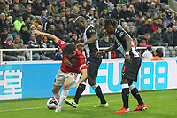 Daniel James of Man Utd holds off Jetro Willems (on loan from Eintracht Frankfurt) of Newcastle United during the Premier League match between Newcastle United and Manchester United at St. James's Park, Newcastle, England on 6 October 2019. Photo by J GILL / PRiME Media Images.