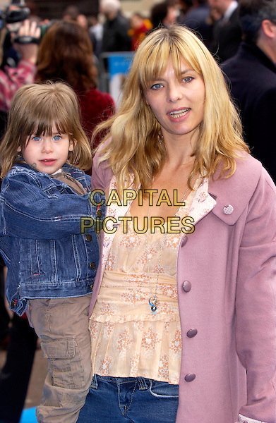 JEMIMA FRENCH.Valiant Premiere, Odeon West End Leicester Square..March 20th, 2005.half length carrying child pink jacket denim jean pink coat.www.capitalpictures.com.sales@capitalpictures.com.©Capital Pictures