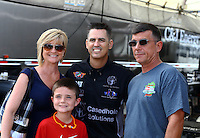 Mar 14, 2015; Gainesville, FL, USA; NHRA top fuel dragster driver Larry Dixon (center) poses for a photo with fans in the pits prior to qualifying for the Gatornationals at Auto Plus Raceway at Gainesville. Mandatory Credit: Mark J. Rebilas-USA TODAY Sports