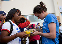 USWNT midfielder Heather O'Reilly signs an autograph for a fan following the game. The USWNT defeated Italy, 2-0, at the Suwon Sports Center in Suwon, South Korea.