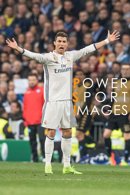 Cristiano Ronaldo of Real Madrid raises his arms during the match Real Madrid vs Napoli, part of the 2016-17 UEFA Champions League Round of 16 at the Santiago Bernabeu Stadium on 15 February 2017 in Madrid, Spain. Photo by Diego Gonzalez Souto / Power Sport Images