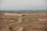 Daytime landscape view from a train of a water dam construction site near Píngyáo county of the Jìnzhōng District in Shānxī Province, China  © LAN