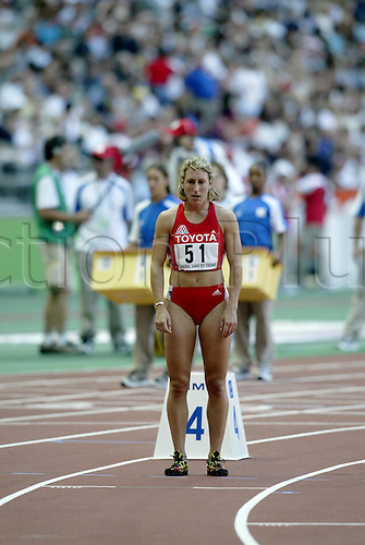 August 24, 2003: Distance runner, 51. STEPHANIE GRAF (AUT) stays focused prior to the start of the Women's 800m Semi-Finals. World Athletics Championships held at the Stade de France, Paris. Photo: Neil Tingle/action plus...runners woman women metres athlete 030824 track and field preparation