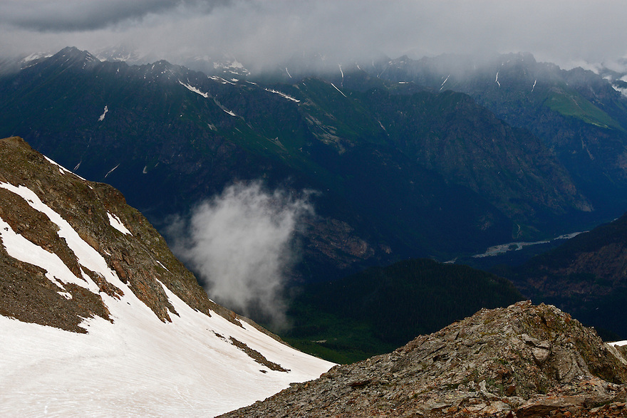 Russia, Caucasus. Teberdinsky biosphere reserve. View from Mussa-Achitar Krugozor near Dombay, around 3000 m asl. Cloud passing.