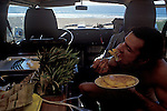 Eating breakfast inside the van along the beach on the Pacific Coast of Mexico, near Novillero.