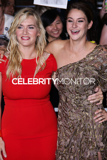 "WESTWOOD, LOS ANGELES, CA, USA - MARCH 18: Kate Winslet, Shailene Woodley at the World Premiere Of Summit Entertainment's ""Divergent"" held at the Regency Bruin Theatre on March 18, 2014 in Westwood, Los Angeles, California, United States. (Photo by David Acosta/Celebrity Monitor)"