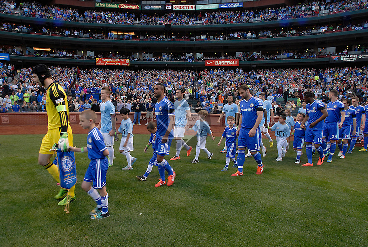 Football - Premier League - Chelsea Training for friendly with Man City St. Louis, MO/USA. Manchester City won, 4-3 over Chelsea. Chelsea and Manchester City players are escorted onto the field holding hands with local children to start the friendly at Busch Stadium, which had been converted from a baseball field for the match.