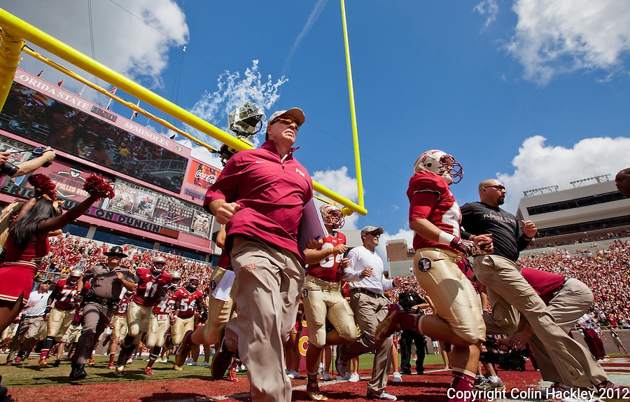 TALLAHASSEE, FL 9/15/12-FSU-WAKE091512 CH-Florida State Head Coach Jimbo Fisher, center, and the Seminoles take the field prior to the Wake Forest game Saturday at Doak Campbell Stadium in Tallahassee. The Seminoles shut out the Demon Deacons 52-0.COLIN HACKLEY PHOTO