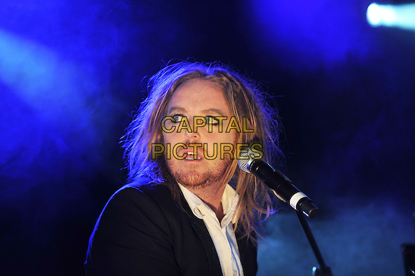 Tim Minchin.Performing live on Day 3 at the Reading Festival, Reading, England..August 28th, 2011.stage concert live gig performance headshot portrait black suit jacket white shirt stubble facial hair  music comedy comedian .CAP/MAR.© Martin Harris/Capital Pictures.