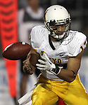 Wyoming's Jason Thompson (17) fumbles the ball against Nevada during the second half of an NCAA college football game in Reno, Nev., on Saturday, Oct. 6, 2012. Thompson recovered the ball. (AP Photo/Cathleen Allison)