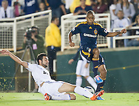 Real defender Raul Albiol (18) tackles the ball against Galaxy forward Tristan Bowen (17) during the first half of the friendly game between LA Galaxy and Real Madrid at the Rose Bowl in Pasadena, CA, on August 7, 2010. LA Galaxy 2, Real Madrid 3.