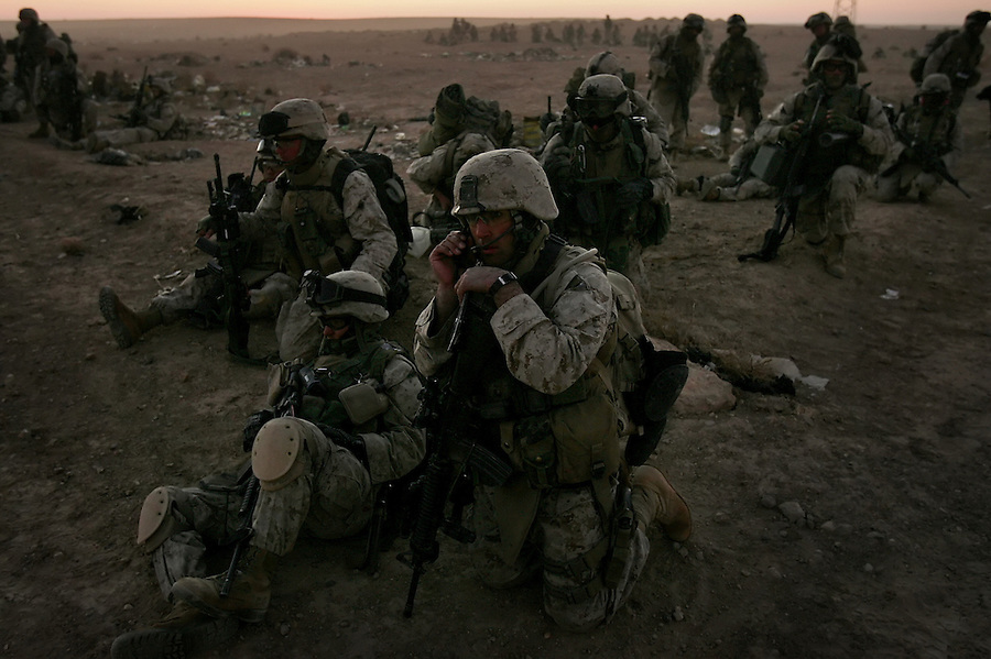 Marines from Golf Co. 2nd Battalion 1st Marines wait in their assault positions for the order to push into the Iraq-Syrian border twon of Obeidi, Iraq on Mon. Nov. 14, 2005 as part of Operation Steel Curtain.